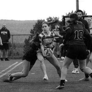 Joueuse de rugby en action